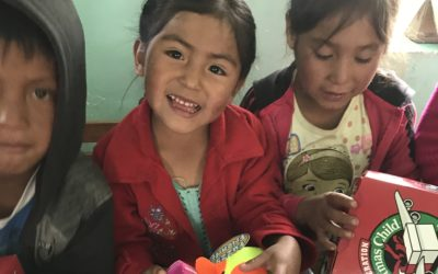 VILLAGE ASMAYACO: The Davis Family Helps Deliver Samaritan's Purse Operation Christmas Child Shoeboxes To A Nearby Village